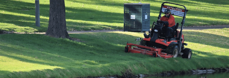A man using a zero turn mower rental.